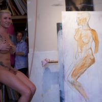 Tattooed trans model Danni Daniels poses totally naked in a studio for a painter