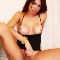 Trans solo model Alessandra Blonde looses her huge breasts and prick from an ebony sundress