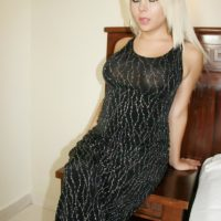 Yellow-haired transsexual Afrika Kampos looses her monster-sized knockers and sausage from a long sundress