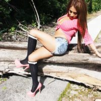 Latina trans-girl Tania Quintilla pulls her gigantic junk out in the country after unzipping jean cut-offs
