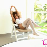 Lovely transsexual Tania Quintilla reveals her hard rack in milky nylons and black heels
