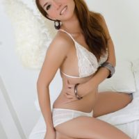 Seductive Asian T-girl Sapphire Young looses her she-dick from a bathing suit to masturbate