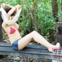 Young tranny Keira Verga models in a bikini while out on an outdoor bench