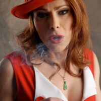 Redheaded trans babe Jasmine Jewels exposes her big tits while smoking in fine clothes