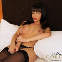 Big-chested brunette TS Mariana Cordoba stroking her monstrous sausage in ebony hose