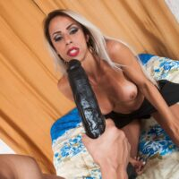 Platinum-blonde Latina Tgirl Bruna Lovately plays anal games with her man friend