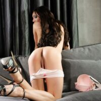 Long-limbed tranny Kimber Lee uncups her immense boobies before playing with her tranny-dick