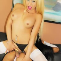 Shemale Tania Quintilla and a shemale gf give each other a oral sex on a couch