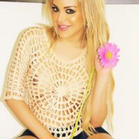 Irresistible yellow-haired tranny Karla Carrillo letting her she-dick free from underneath a miniskirt