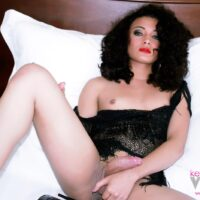 Dark haired trans model Keira Verga tugs on her monster-sized sausage while toying her starfish