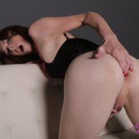 Redheaded transsexual Mandy Mitchell fingers her asshole while jerking off in lingerie