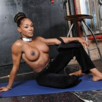 Busty black shemale Natalia Coxxx gets totally naked on top of a yoga mat by herself