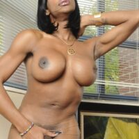 Ebony transsexual model Natalia Coxxx takes off leather pants to pose completely naked